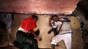 在暴力中长大 天真儿童被迫加入军事组织杀人