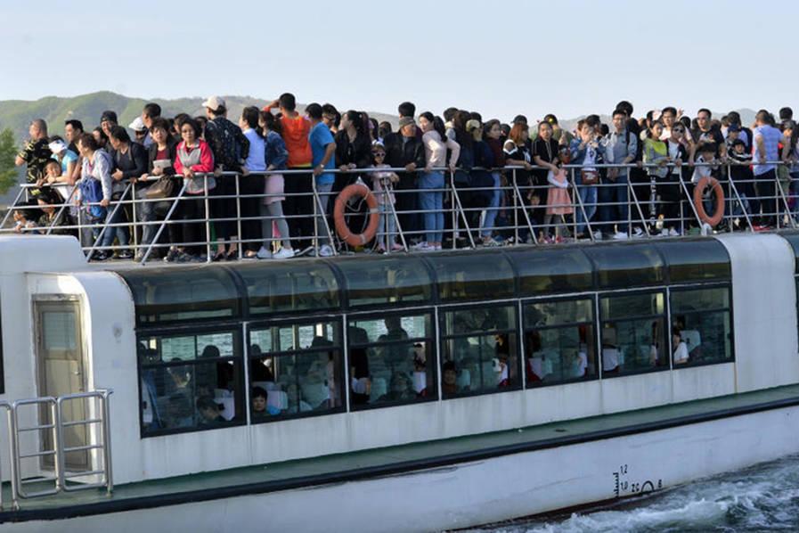 为看朝鲜别样风景 游客挤爆鸭绿江畔 - 谭笑古今 - 谭笑古今
